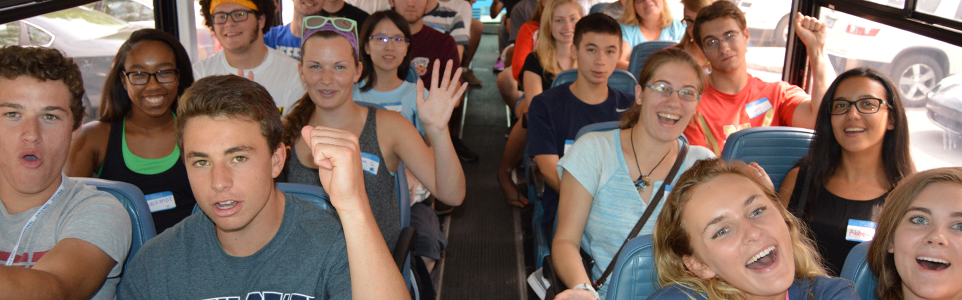 students on bus to TOTEMS orientation