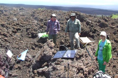 Seismology field crew recovering a seismic station at Sierra Negra caldera, Galapagos Islands, Ecuador.