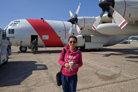 photo of someone standing in front of planes
